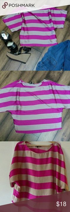 Express striped top!  Size large pink This is such a cute top! I never wear it.  Pink stripes. There is a small black mark shown in photo three. Not a clue where it came from.  Size large. Very nice flowing top. 100% polyester. Express Tops Tees - Short Sleeve