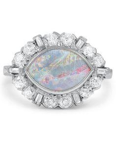 "Opal Engagement Rings That Are Oh-So Dreamy   Martha Stewart Weddings - Brilliant Earth ""Loyce"" opal and platinum engagement ring, $6,000, brilliantearth.com."