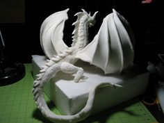 these wings.. I like these.. idk how the dragon would work on the cake. not really liking that part