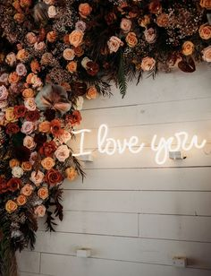 A Moody Fall Wedding with a blush wedding dress by Hayley Paige, large floral installations, a 42ft charcuterie table and magical fairy lights for the reception. #fallwedding #gws #greenweddingshoes #moodywedding #warmweddingcolors #blushdress #floralweddingdress #fallweddingideas Flower Wall Wedding, Floral Wedding, Wedding Flowers, Wedding Dress, Dream Wedding, Fall Wedding Decorations, Fall Wedding Colors, Autum Wedding, Fall Wedding Table Decor