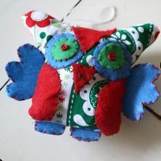 This trendy Owl Christmas Ornament will make a great addition to your tree this holiday season!
