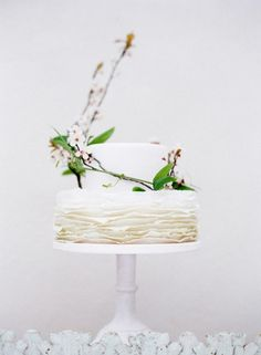 Ruffled cake adorned with fresh florals and greenery | http://www.adornmagazine.com/blog | Photography by Amanda Crean