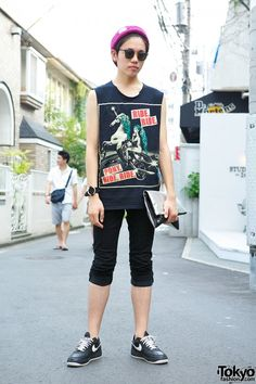 """Sep 2013: Shin is wearing a self-modified Lady Gaga """"Ride Ride Pony Ride Ride"""" (Highway Unicorn) sleeveless tee and Uniqlo pants, together with a silver clutch and Nike sneakers. He accessorized with a purple beanie, sunglasses, a leather cuff, and thumb ring."""