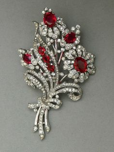 Ruby bouquet ... Flower spray pin clip by Alfred Philippe for Trifari, rhodium plated cast base metal with ruby glass and clear rhinestones, USA ca. 1940 - Private Collection -