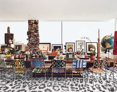 Surrounded by Franz West chairs, the Émile-Jacques Ruhlmann table in Diane von Furstenberg's Manhattan office/living area often does double duty as a desk and dining table. A Joan Miró etching, a Francesco Clemente painting, and family photographs are displayed on the windowsill.