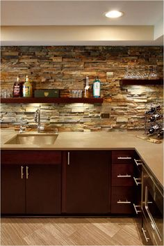 Basement Bar Design Idea- remove those upper cabinets and do stone with shelves - Modern Small Basement Bars, Basement Bar Plans, Basement Bar Designs, Modern Basement, Basement Kitchen, Basement Renovations, Stacked Stone Backsplash, Faux Walls, Small Basements