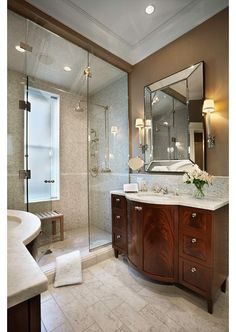 Finishes are nice and warm...but the shower would not have a curb and the sink would be open underneath the solid surfacing...