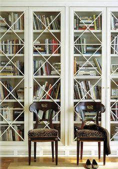 Built in bookshelves with glass doors.