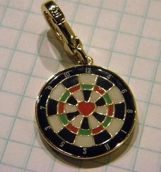 Juicy Couture dartboard charm, bought in Chicago at the Juicy store