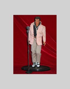 Elvis Doll on Stand with Microphone. $24.99, via Etsy.