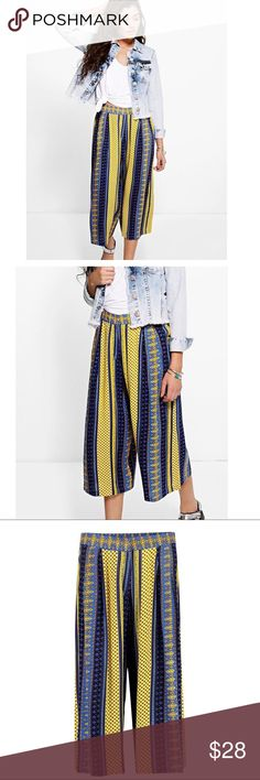 Boohoo pants blue yellow printed NWOT These are such cute pants! In excellent condition, no flaws. US size 2. Colors are beautiful! Features hidden zipper, button and clasp (see photos) Boohoo Pants Ankle & Cropped
