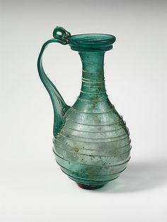 The Metropolitan Museum of Art - Glass jug, Late Imperial Date: 3rd–4th century A.D. Culture: Roman Medium: Glass Dimensions: H.: 5 1/4 x 2 5/8 x 1 1/2 x 15/16 in. (13.3 x 6.7 x 3.8 x 2.4 cm) Classification: Glass