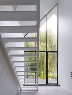 Dutch interior design practice Studio Niels show us through their minimalist, monochrome farmhouse 'The Bright White House' in The Netherlands. White Sheer Curtains, Curtains With Blinds, Window Reveal, Roof Structure, Glass Facades, White Farmhouse, Staircase Design, Home Studio, Large Windows