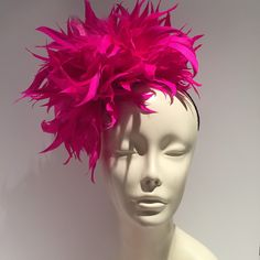A personal favorite from my Etsy shop https://www.etsy.com/listing/451207096/fuschia-feather-headband-pink-fascinator