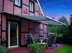 Markilux 1550 patio awning with lights draws the bugs away from the house while producing a pleasant downward glow.