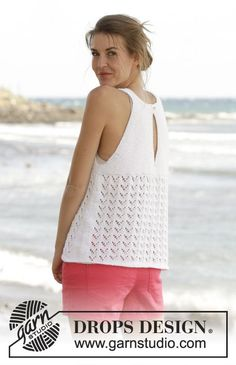 """Holiday Bliss - Knitted DROPS top in garter st with lace pattern and vent mid back in """"Cotton Light"""". Worked top down. Size S-XXXL. - Free pattern by DROPS Design"""