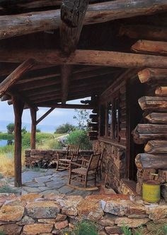 rustic log cabin porch with stonework