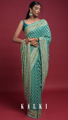 Ocean green banarasi saree in georgette with weaved buttis along with kundan work. Further enhanced with zardozi and cut dana work on the border and pallu. Paired with a matching unstitched blouse in georgette. Stylish Sarees, Stylish Dresses, Fashion Dresses, Saree Fashion, Lehenga Style Saree, Saree Look, Indian Dresses, Indian Outfits, Bridal Lehenga Collection