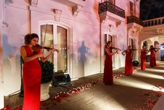 """Also along the path, female violinists in long red satin gowns played classic songs such as """"Moon River,"""" """"Over the Rainbow,"""" and """"Fly Me to the Moon."""" Photo: Sean Twomey/2me Studios"""