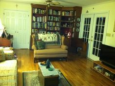 Simple wood floors, sawyer box, loveseat and sofa.  It's coming together.