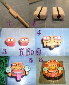 Face cane by K Ro - K Do - Aztec symbol?