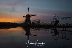 Dutch waters - Kinderdijk at sunset Unesco windmills Holland