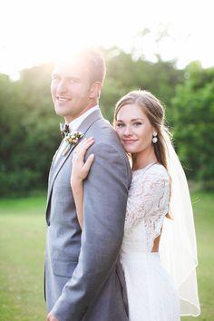 bride behind the groom