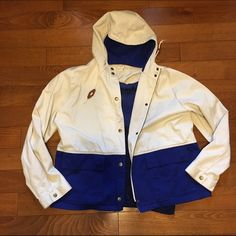 Factory colorblock anorak Perfect over coat for spring. Bold cobalt blue bottom with cream top. Adorable toggles on hood drawstrings. Zip and snap closure. Large pockets. Worn maybe twice. In perfect pre owned condition. No rips stains or tears. Item no a1487. Jcrew factory not retail. J. Crew Jackets & Coats