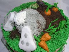 Bottom's Up! - I took susanscakebabies great idea and added an Easter spin to it.  Almond cake, orange marmelade filling.  Veggies are gumpaste, feet are RKT with fondant/buttercream, and dirt is chocolate graham crackers.  Thanks for looking!