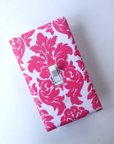 A cute, cheap accessory for a baby girl nursery - hot pink damask light switch cover