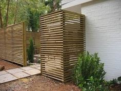 Tall, horizontal slat fence to make a patio space more private. Love the simplicity and clean lines.