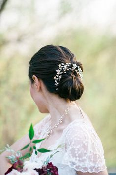 Accent a classic chignon with a crystal-studded headpiece for a glam touch to your bridal style. {Jennifer Manzi Photography}