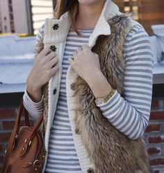 mix of fur and sweater vest