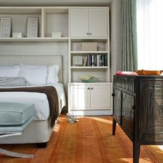 small bedroom storage - idea for Moms - above bed only, in our case.
