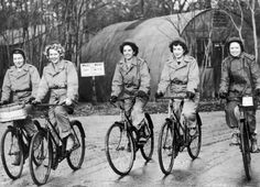 Members of the Women Army Corps (WAC) stationed at a U.S. medium bomber station in England, ride bicycles on their way to work on Dec. 22, 1943.