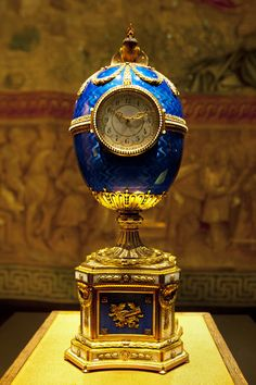 The Faberge Blue Serptent Clock Egg presented by the Czar to his wife on Easter 1895.  The clock eggs are the only Faberge eggs that do not have a 'surprise' hidden in the centre, certainly because they are working clocks.  Gold and guilloche enamels.