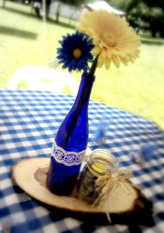 centerpiece:  tree slab, blue wine bottle and mason jar.