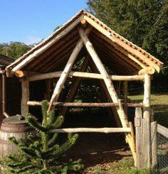 Artizans of Wood  Roundwood trusses  strawbale  natural building  woodstorage  inspiration