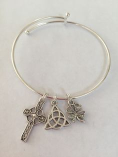 Celtic cross, knot and 4-leaf clover bracelet - great for all things Irish by MonkeyBaubles on Etsy