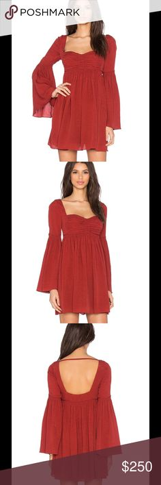 FREE PEOPLE Silk Dress Free People invokes a spirit of femininity and creativity.  This exquisite dress features:   Shell: 100% silk Lining: 100% poly Dry clean only Fully lined Side hidden zipper closure Color: Deep Red Free People Dresses Long Sleeve
