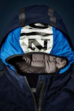 Autumn/Winter '15 #DEEPBLUE collection preview: parka coat made of heavy duty fabric with hidden feather padded hood.