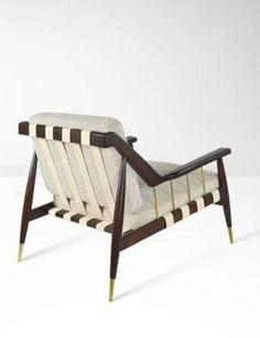 Edmund Spence; Walnut and Brass 'Urban-Aire' Lounge Chair, 1950s.