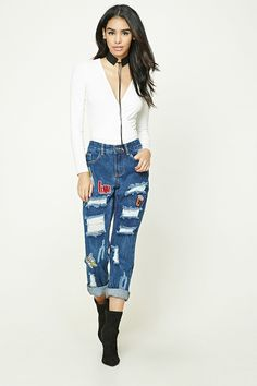 A pair of boyfriend jeans featuring various patch graphics including a banana and fries, distressed front, mid-rise, cuffed ankles, a five-pocket construction, and a zip fly.