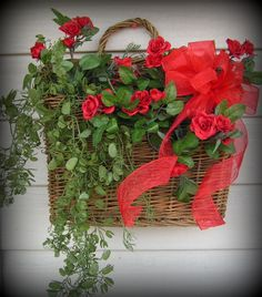 "Willow Basket with handle , you can hang the basket, or sit it as shown in pictures........SO Pretty, has greenery and red roses....I will be happy to do this in any color you want....These are one of my best sellers...:-) 18"" tall, 11"" long, and 4"" wide. $27.99"