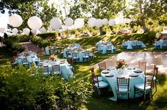 The Tiffany Blue linens and Chivari chair pads add a touch of elegance to the organic charm of the farm's outdoor reception space. When the sun goes down the white paper lanterns will add a romantic glow for the dancing. Wedding Venue: Bear Flag Farm in Winters, CA Wedding Planner: Tina Reikes of Bear Flag Farm  Wedding Photographer: Shelly Kroeger Photography