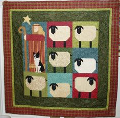 """The quilt """"Shepherds' Fold"""" measures 54 3/4 inches square and is based on the design by Nancy Halvorsen. The Border Collie is based on a dog rescued by Arizona Border Collie Rescue"""