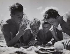 Reading boys by Herbert List. 1950's.