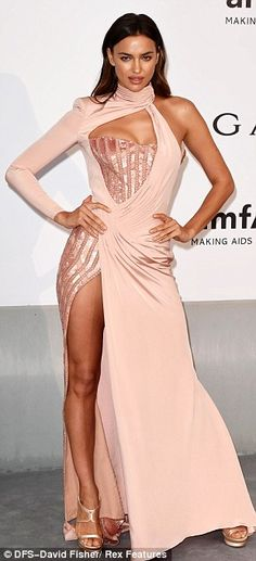 Model mayhem: Rosie Huntington-Whiteley, Irina Shayk and Lara Stone stole the show at the amfAR Cinema Against AIDS gala held at the famous Hotel du Cap-Eden-Roc on Thursday evening