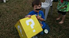 Mario party. Mario Piñata and moustache pencil favor. Covered cardboard box with construction paper and used cricut to cut question marks.