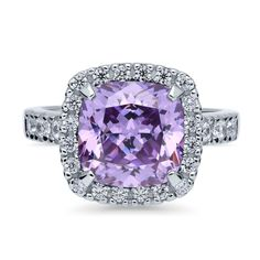 This halo ring is a new take on elegance. Classic design meets a romantic, eye-catching hue in this contemporary accessory. Made of rhodium plated fine 925 sterling silver. Features 3.87 carat cushion cut purple cubic zirconia (10mm) in 4-prong setting. Accented with 0.48 ct.tw round cut cubic zirconia in prong setting. Band measures 2.3mm in width.